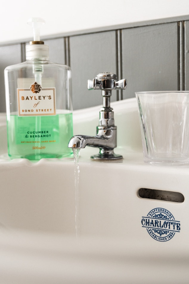 faucet on white tiles